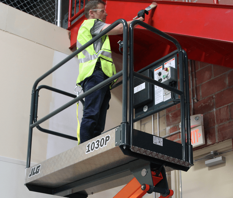 Operator hanging drywall with JLG® EcoLift